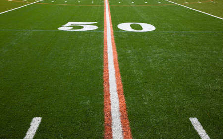 american football field: The 50 yard line of an American football field