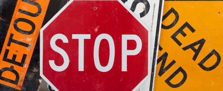 Old, vintage traffic signs including a stop sign, a detour sign, and a dead end sign making a background   Caution theme Stock Photo - 14569214