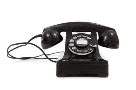 telephone: A vintage, black 1940 desk telephone