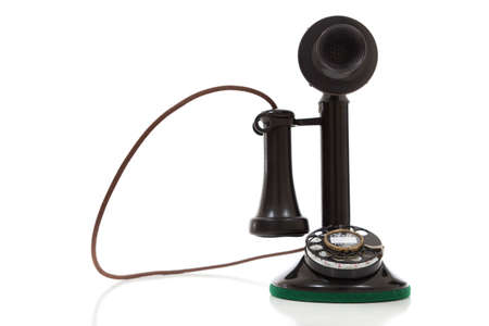 telephone: antique, vintage candlestick telephone on a white backgournd