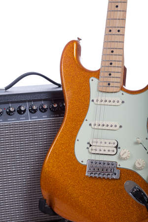 guitar amplifier: An oranage electric guitar and amplifier