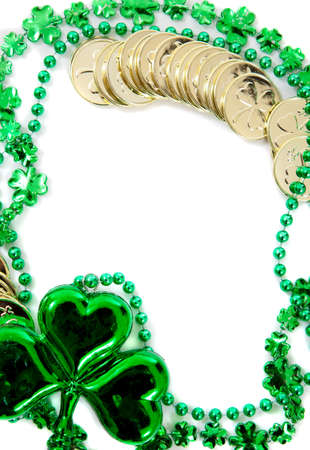 St. Patrick's day border including green shamrock and gold coins on a white background Stock Photo - 17288188