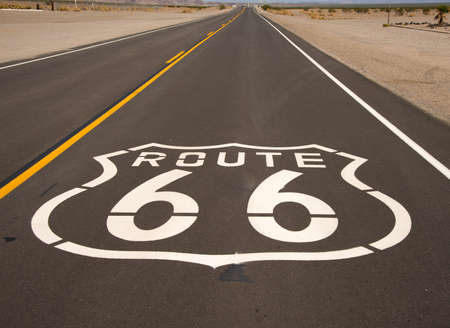 A hisoric Route 66 emblem painted on the surface of a highway photo