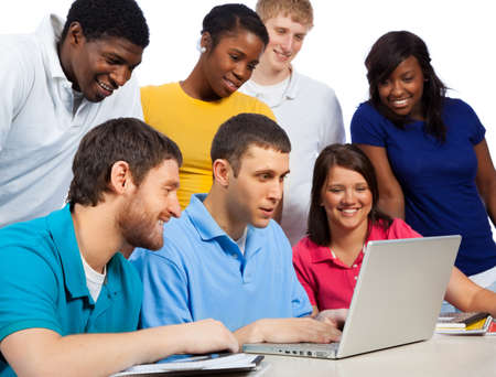A group of multi-cultural college studentsfriends gathered around a computer photo