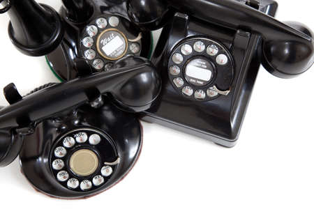 A group of vintage telephones on a white background photo