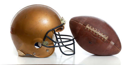athletic gear: A retro football helmet and football on a white background
