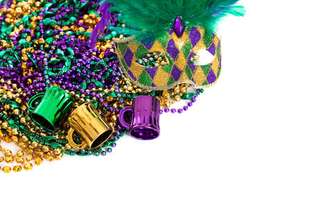 colorful beads: Assorted colored Mardi gras beads on a white background with copy space
