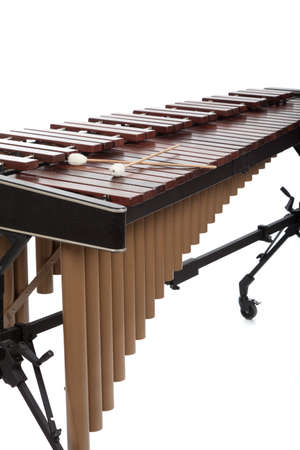 A wooden marimba and mallets on a white background photo