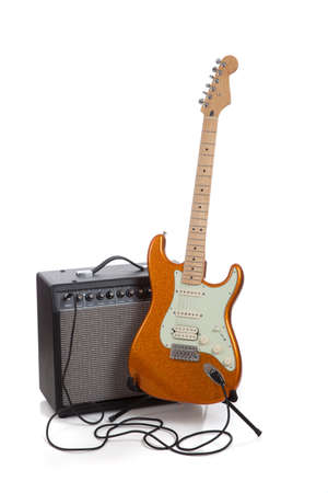 guitar: An amplifier and an electric quitar on a white background Stock Photo