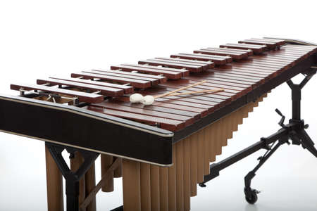A wooden marimba and mallets on a white background 스톡 콘텐츠