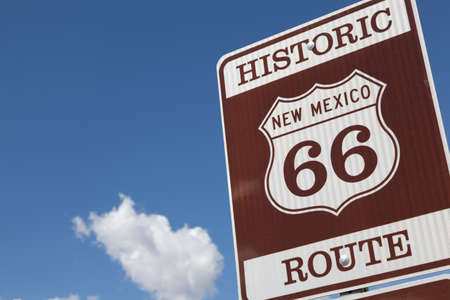 A Historic Route 66 road sign with a sky blue background photo