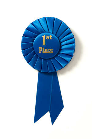 A first place blue ribbon on a white background Banco de Imagens