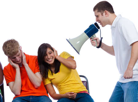Young friends being yelled at by another with a bullhorn on a white background photo