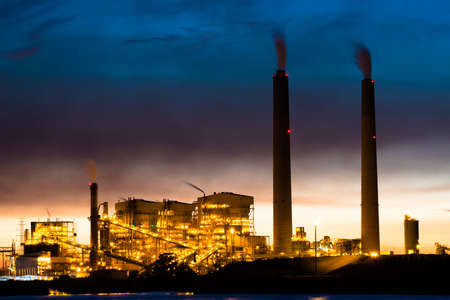 coal plant: A coal power plant lit up at night Stock Photo