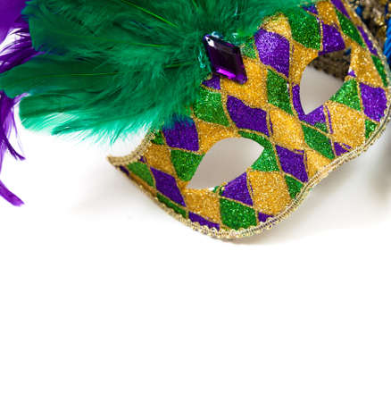 A glittery Mardi gras mask on a white background with copyspace photo