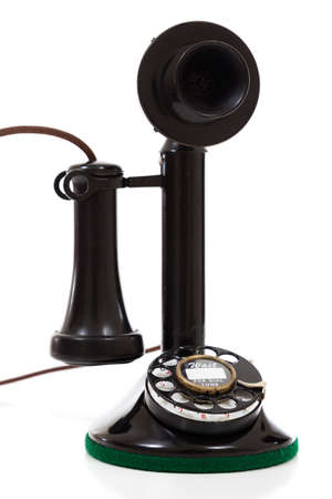 A Black vintage candlestick phone on a white background