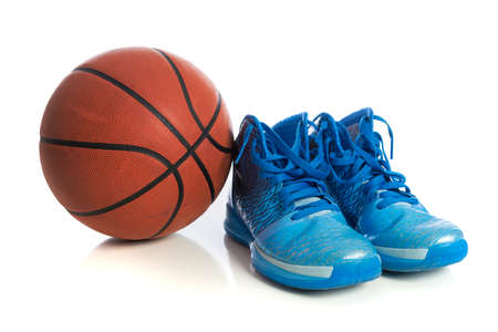 A basketball with blue high tops on a white background photo