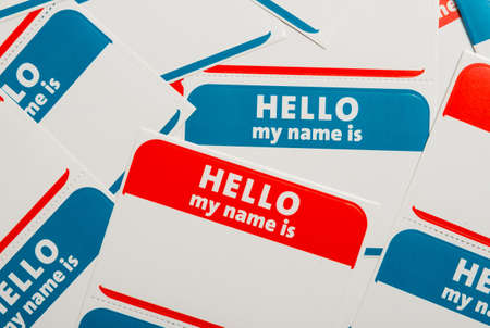 name tags: A stack of blue and red  Hello, my name is  name tags or badges