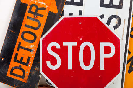 Detour sign, stop sign and road closed sign as a background Imagens