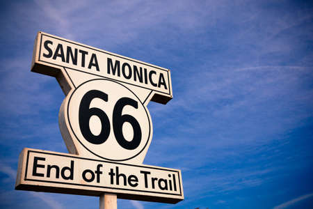 The Historic Route 66 Santa Monica Sign with a sky blue background photo