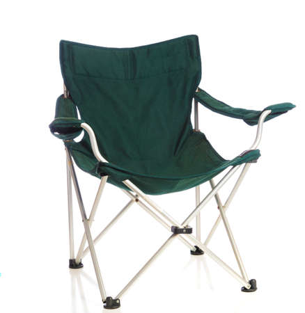 A green folding lawn chair on a white background