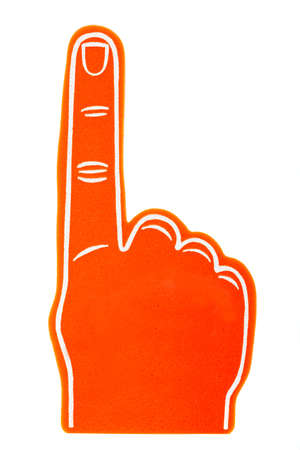 index finger: An orange foam fan finger on a white background Stock Photo