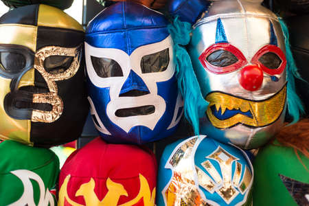 objects: Arrangement of various colored luchador masks as a background