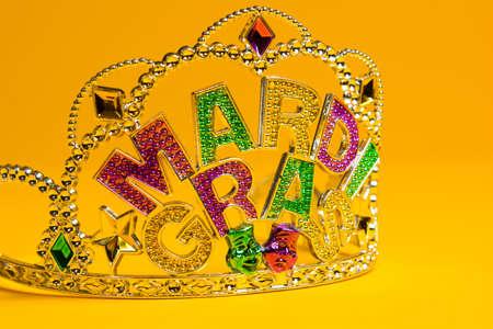 jeweled: A jeweled Mardi Gras crown on a yello backgroung