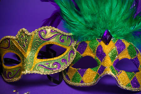 masquerade masks: Festive Grouping of mardi gras, venetian or carnivale mask on a purple background