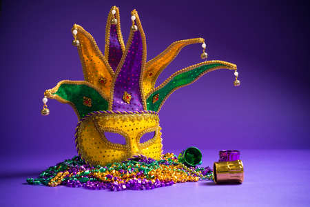 Festive Grouping of mardi gras, venetian or carnivale mask on a purple background photo