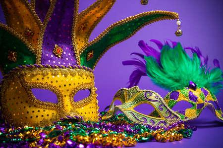 Festive Grouping of mardi gras, venetian or carnivale mask on a purple background