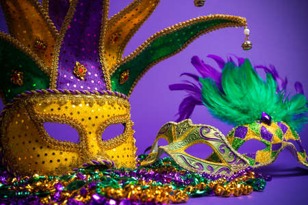 grouping: Festive Grouping of mardi gras, venetian or carnivale mask on a purple background