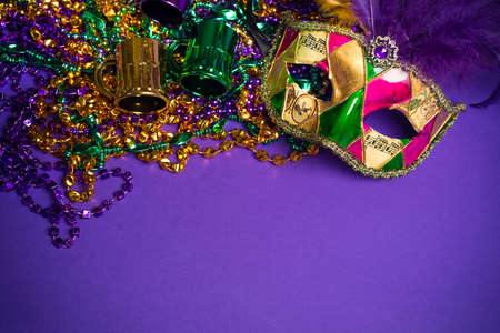 carnival masks: Festive Grouping of mardi gras, venetian or carnivale mask on a purple background