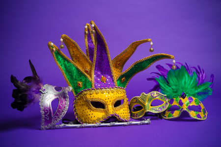 tacky: Festive Grouping of mardi gras, venetian or carnivale mask on a purple background