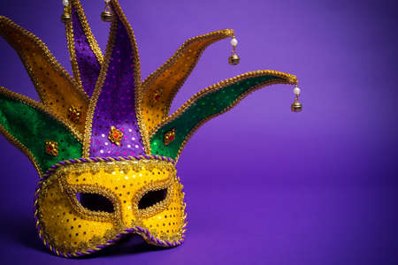 masquerade masks: Festive mardi gras, venetian or carnivale mask on a purple background