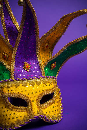 Festive mardi gras, venetian or carnivale mask on a purple background photo