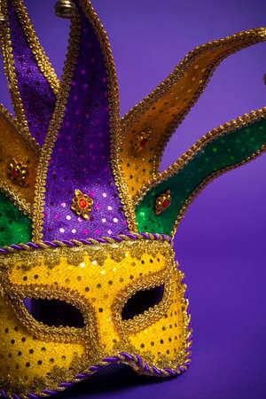 mardi gras background: Festive mardi gras, venetian or carnivale mask on a purple background