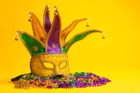 A festive, colorful mardi gras or carnivale mask on a yellow background   Venetian masks  photo