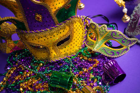 Festive Grouping of mardi gras, venetian or carnivale mask on a purple  photo