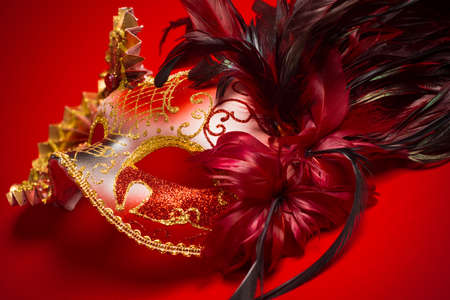 mardigras: A red, gold and black mardi gras or venetian mask on a red