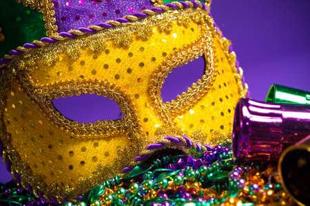 mardigras: Festive Grouping of mardi gras, venetian or carnivale mask on a purple