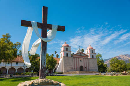 Mission Santa Barbara in Santa Barbara, California with a crosee and a sky blue background