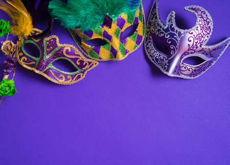 Mardi Gras or carnival mask on bright purple background Stock Photo - 44669564
