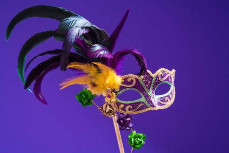 mardigras: Mardi Gras or carnival mask on bright purple background