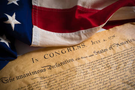 preamble: United States Declartion of Independence with vintage flag.  July 4th.