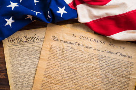 declaration: The Declaration of Independence and Constitution of the United States of America with a vintage flag