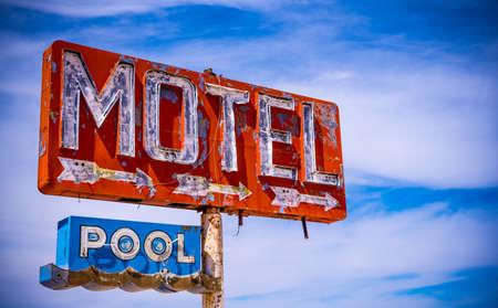 decrepit: An old direpit, flaking neon motel sign in the American Desert