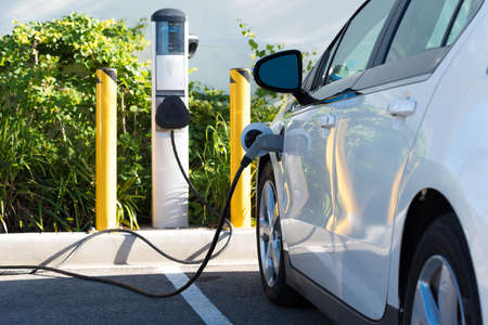 electric socket: An electric car charging in California Stock Photo