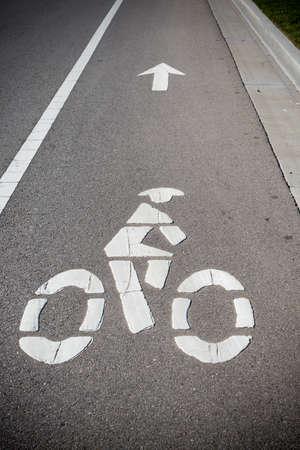 bicycle lane: A bike lane or bikeway symbol on asphalt roadway Stock Photo
