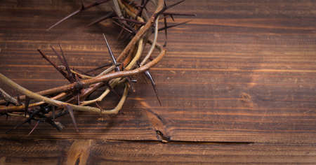 humility: A crown on thorns, a religious symbol on a wooden background - Easter background Stock Photo